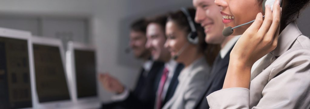call center worker accompanied by her co-workers